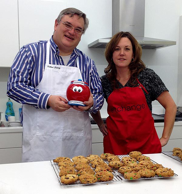 Michelle and Father Larry with cookies